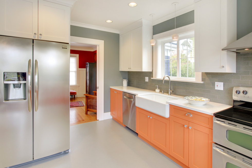 The Orange Cabinets Help Illuminate Kitchen Making It An Animated E To Live Work And Play Project Also Included A New Master Bathroom